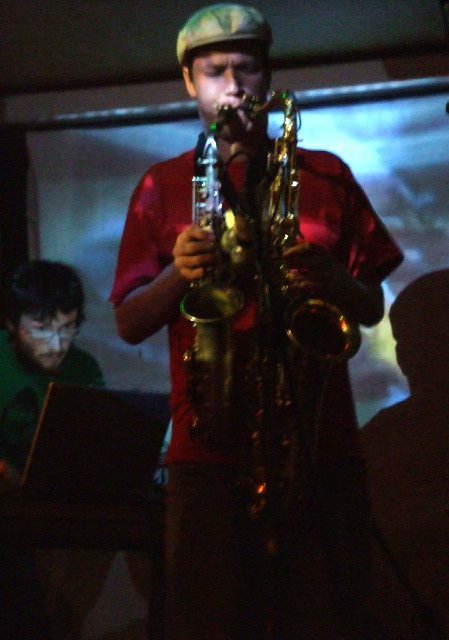 finn playing 2 saxaphones